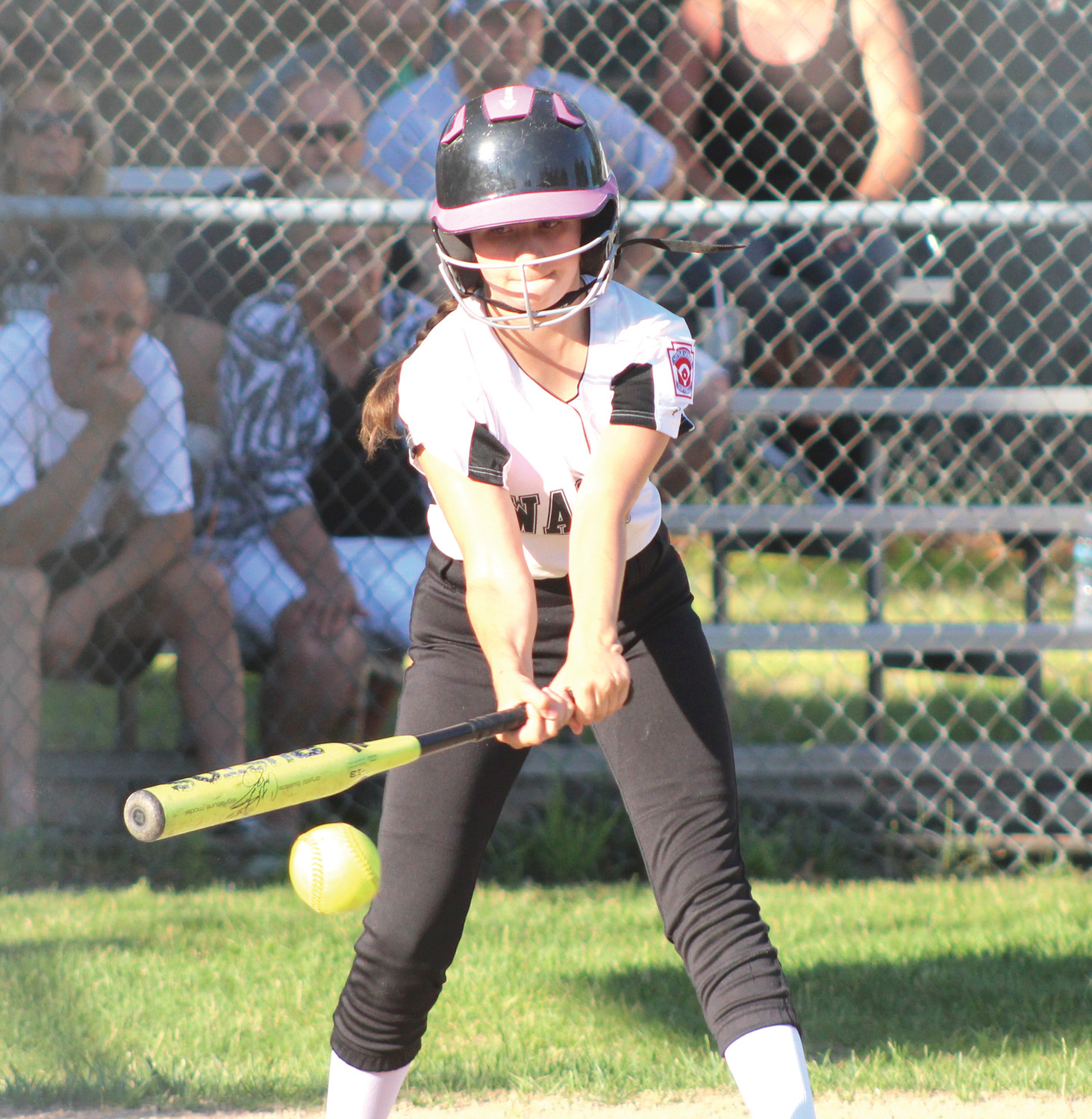 Michelle Maron drives the ball down the first base line against Coventry.
