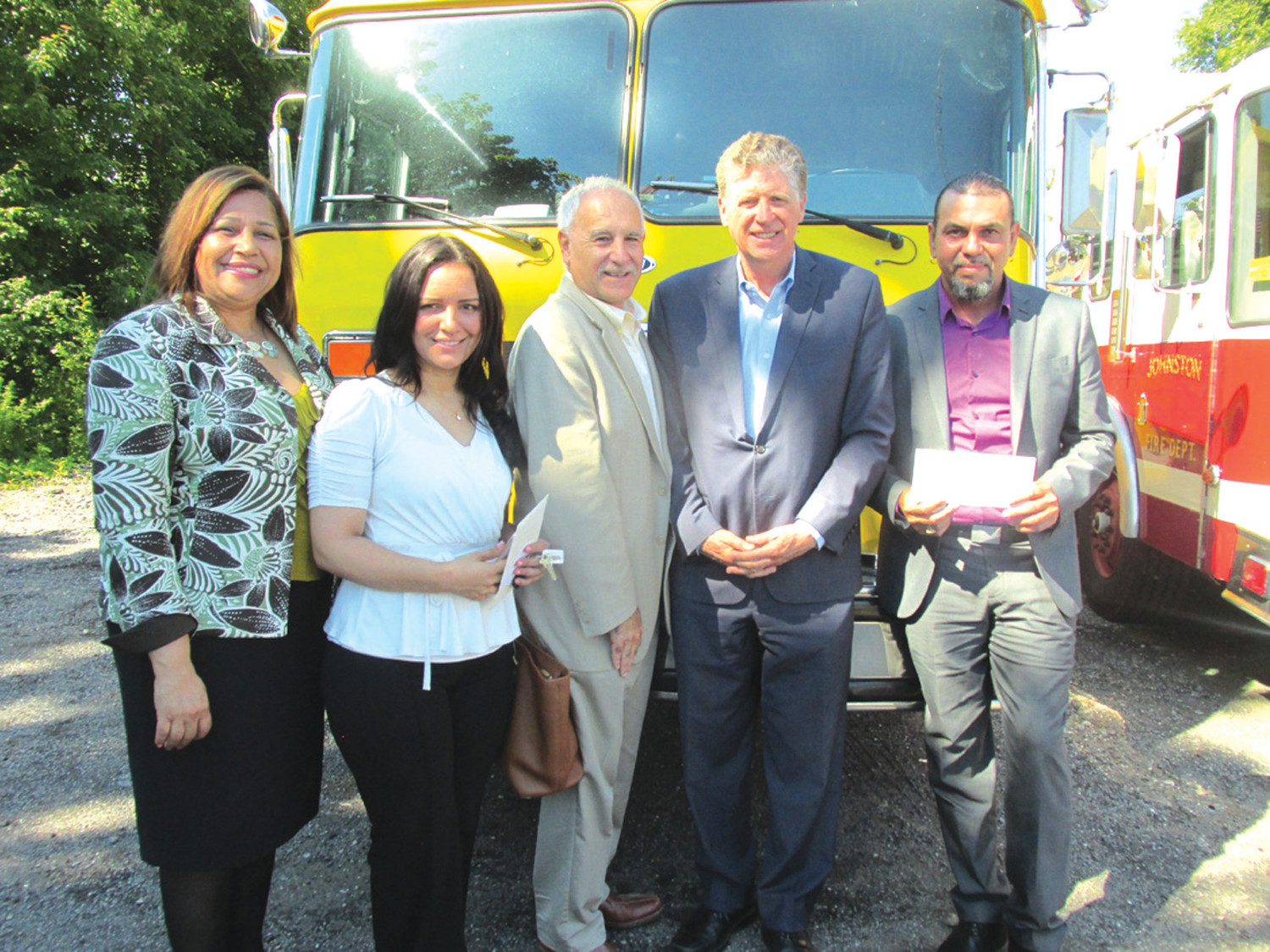 GOODWILL GROUP: RI State Sen. Ana B. Quezada, Carol Aguasvivas, Mayor Joseph Polisena, Lt. Gov. Dan McKee and Julio Ortiz are all smiles after the Town of Johnston donated two fire trucks and as many life saving inflatable boats that will be of great use in the Dominican Republic.