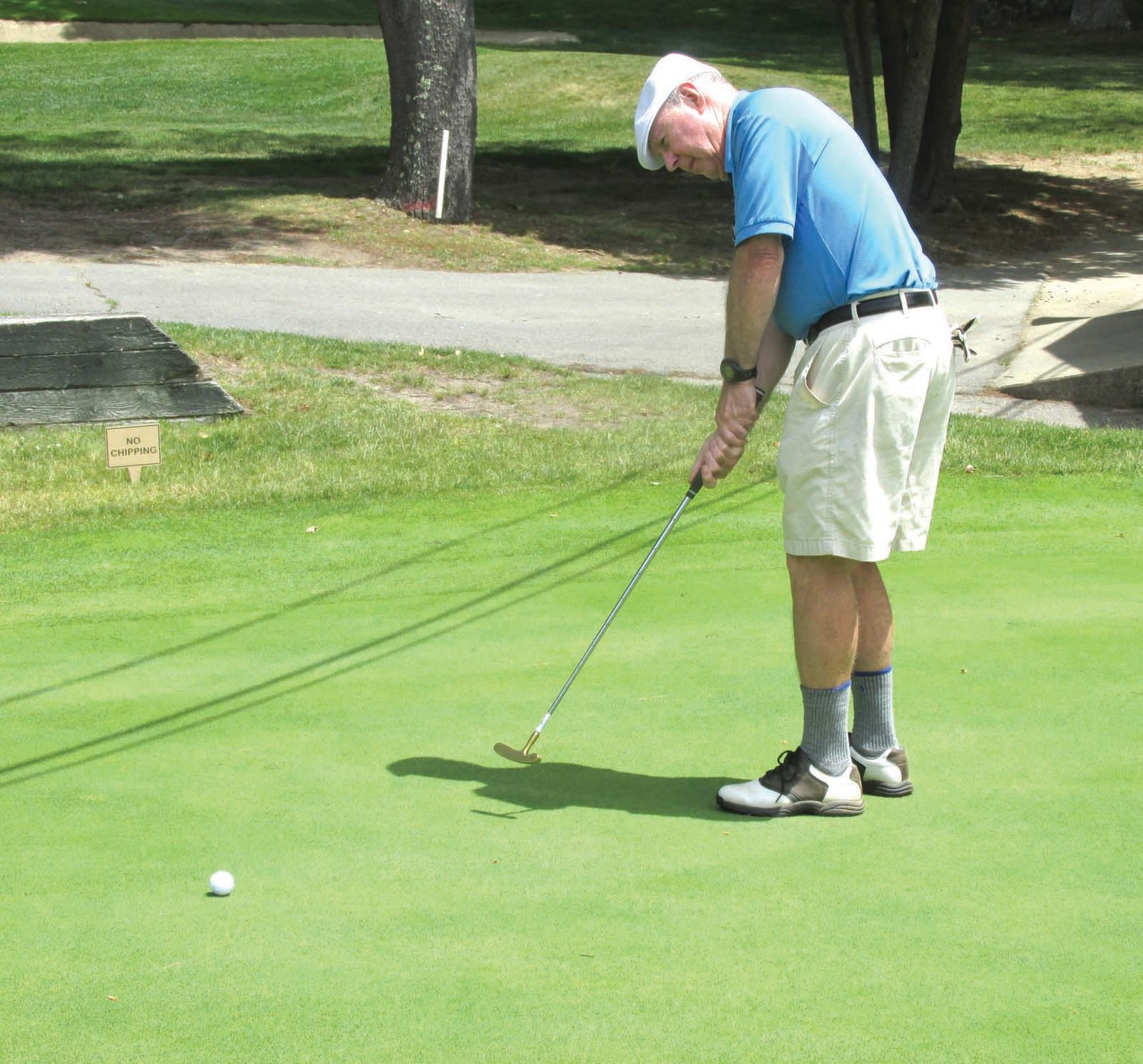 PERFECT PUTT: Former schoolboy sports writer Tim Geary, whose career included covering JHS athletics, tests his mettle during the pre-tourney putting contest held recently at Glocester County Club.