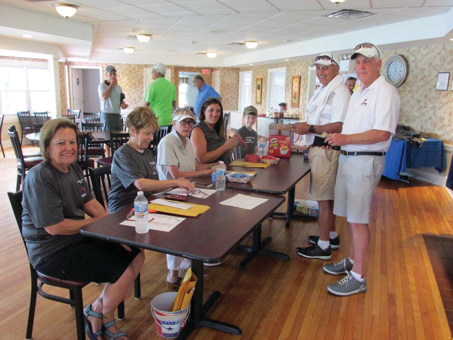 WARM WELCOME: Lois Hopkins, Jan Zucchi, Samantha Mazzie and Shawn Hopkins are all smiles after checking in golfers like Vin LaFazia and Bruce Vittner at the recent Gary V. Mazzie Memorial JHS Athletic Hall of Fame Golf Tournament.