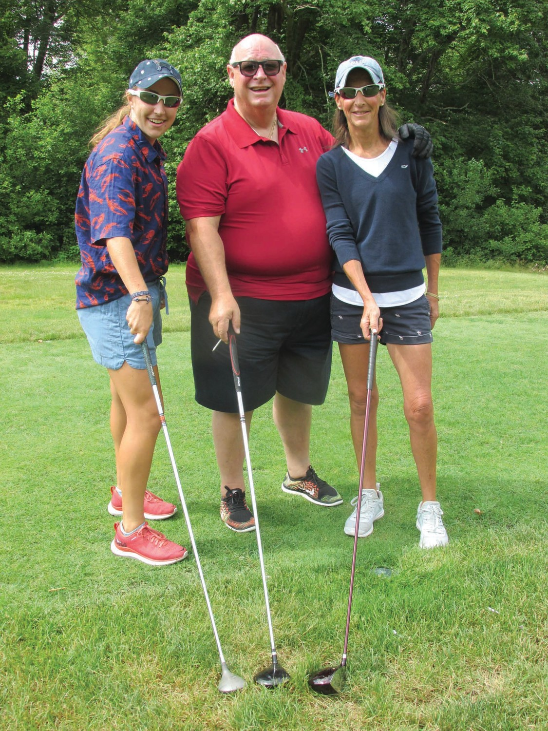 GROUP GOWER: Our Lady of Grace Pastor Rev. Peter J. Gower played in his parishes first ever golf tourney with his sister Marie Gower and Caitlin Marino.