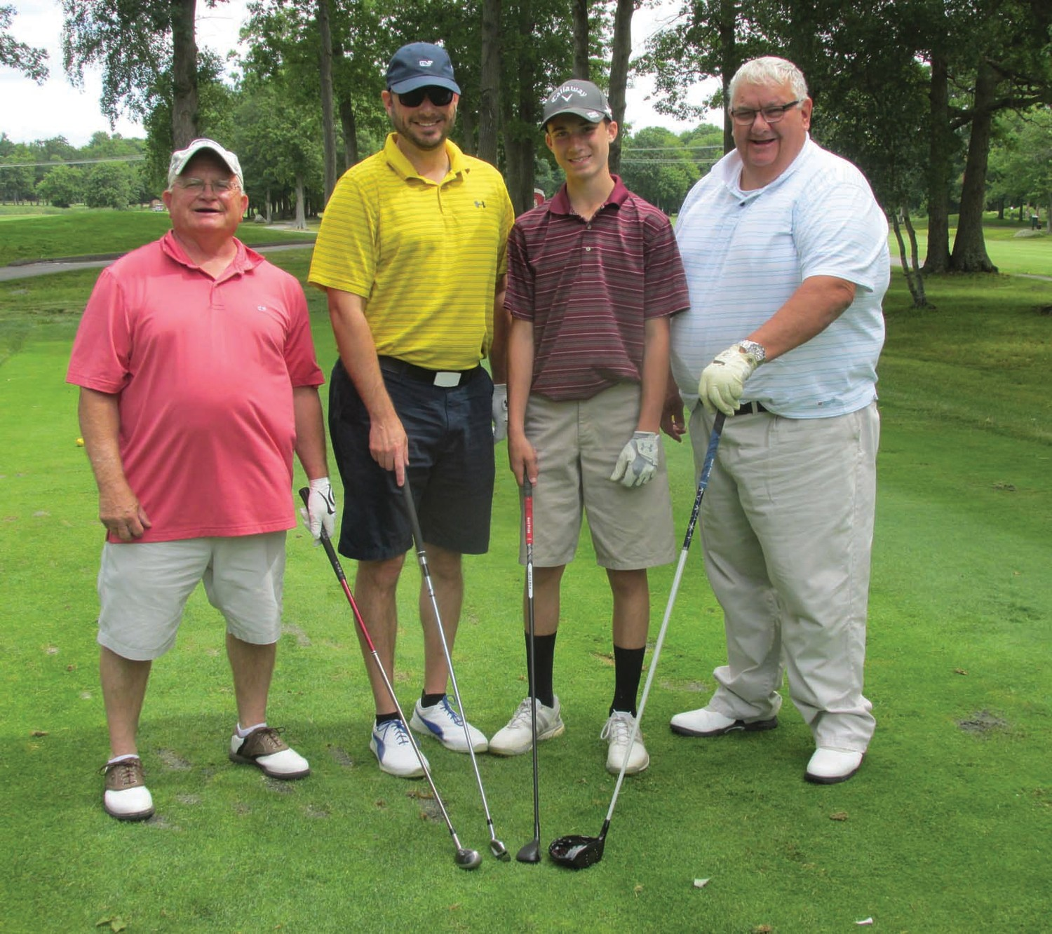 GENERATION GOLFERS: Above, Ray Ouellette (left) played in this foursome of three generations of the Dutelle family – Ray Jr., Keegen and Ray Sr. during the first-ever Our Lady of Grace Golf Tournament.