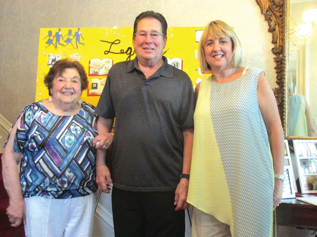 FATHER'S FRIENDS: Rev. Robert Rochon is joined by Louisa Iannotti (left) and Cindy Pagliaro during Sunday's Retirement Reception in Providence.