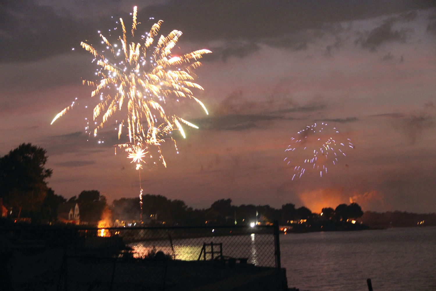 fireworks exploded in colorful frenzies all throughout the city on July 3. These blasts were seen from the shores of Conimicut in Warwick.