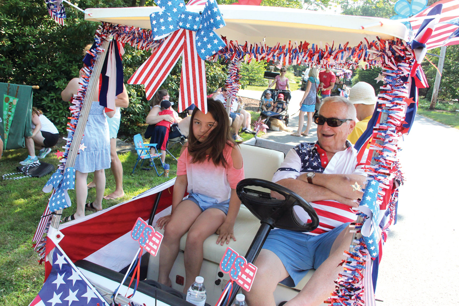 RED, WHITE, BLUE AND RIDING: Bob Sangster had the company of Layla Perry as they waited for the start of the July 4th parade.