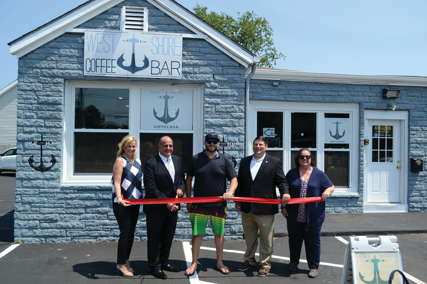 Jedson, Solomon, Dan Saffer, McAllister and Vella-Wilkinson cut the ribbon for West Shore Coffee Bar.