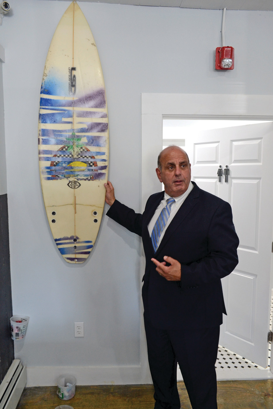 SURFS UP: Mayor Solomon inquires if he can get a surfboard on the wall of his office at Warwick City Hall.
