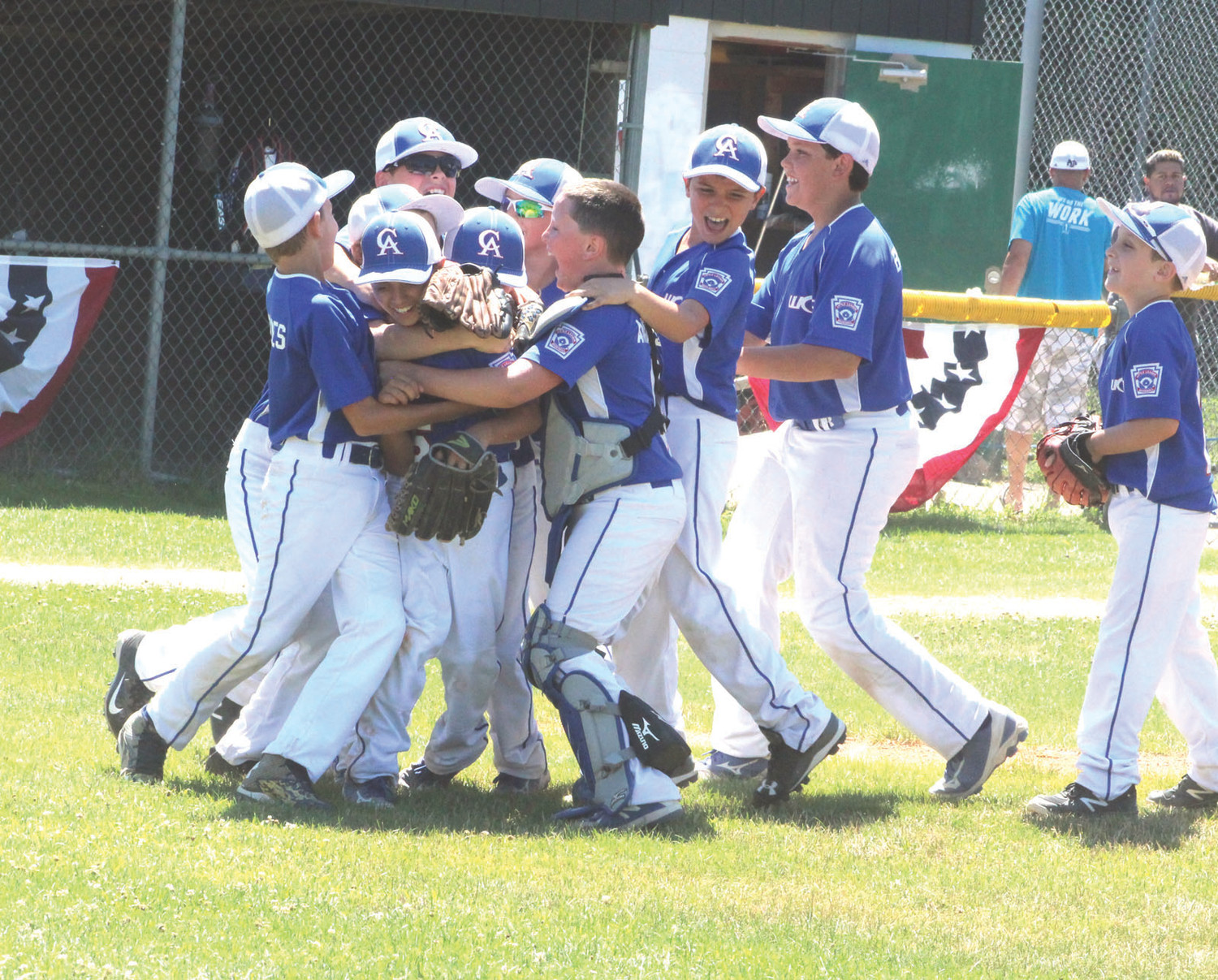 VICTORY LAP: The Warwick Continental American Little League team celebrates after winning the District 3 title.
