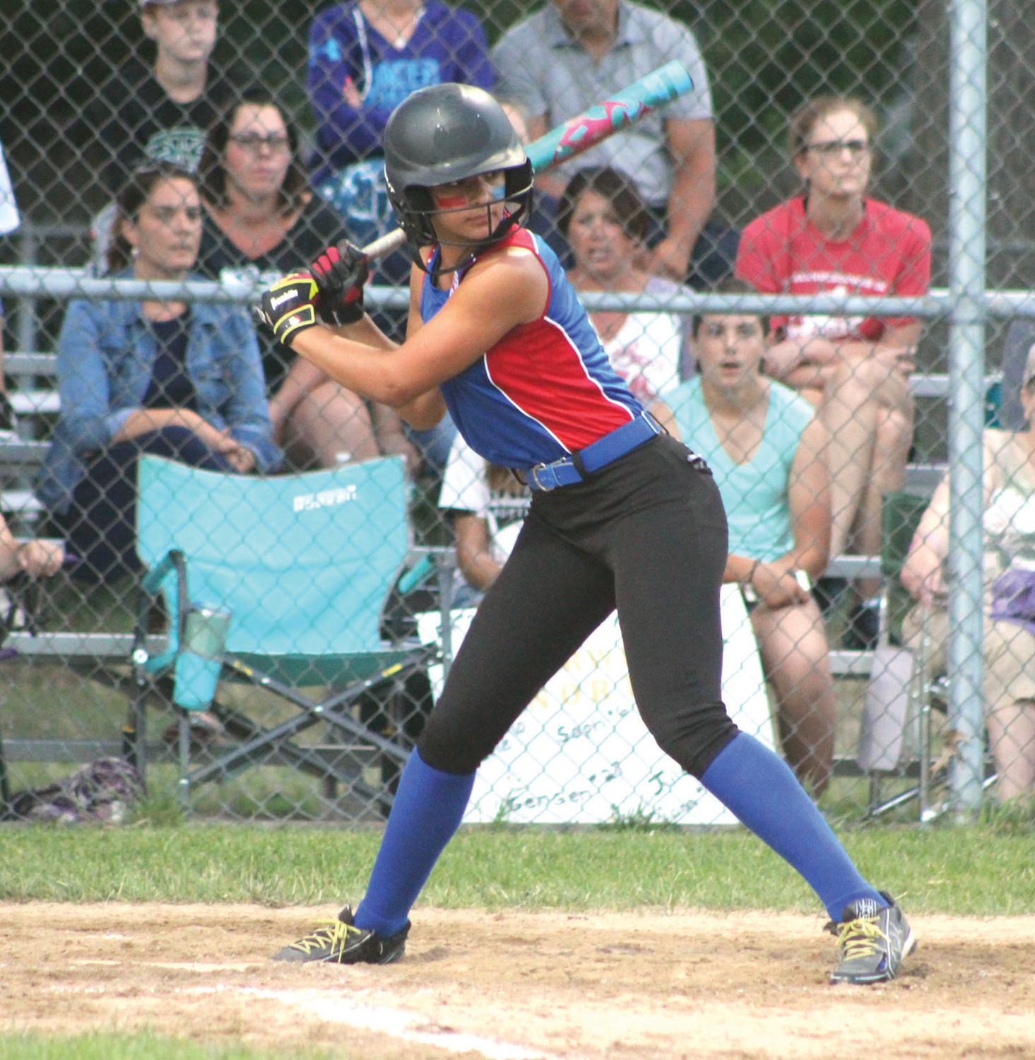 PLAYING THE FIELD: CNB's Ava Santo at bat against Warwick North.