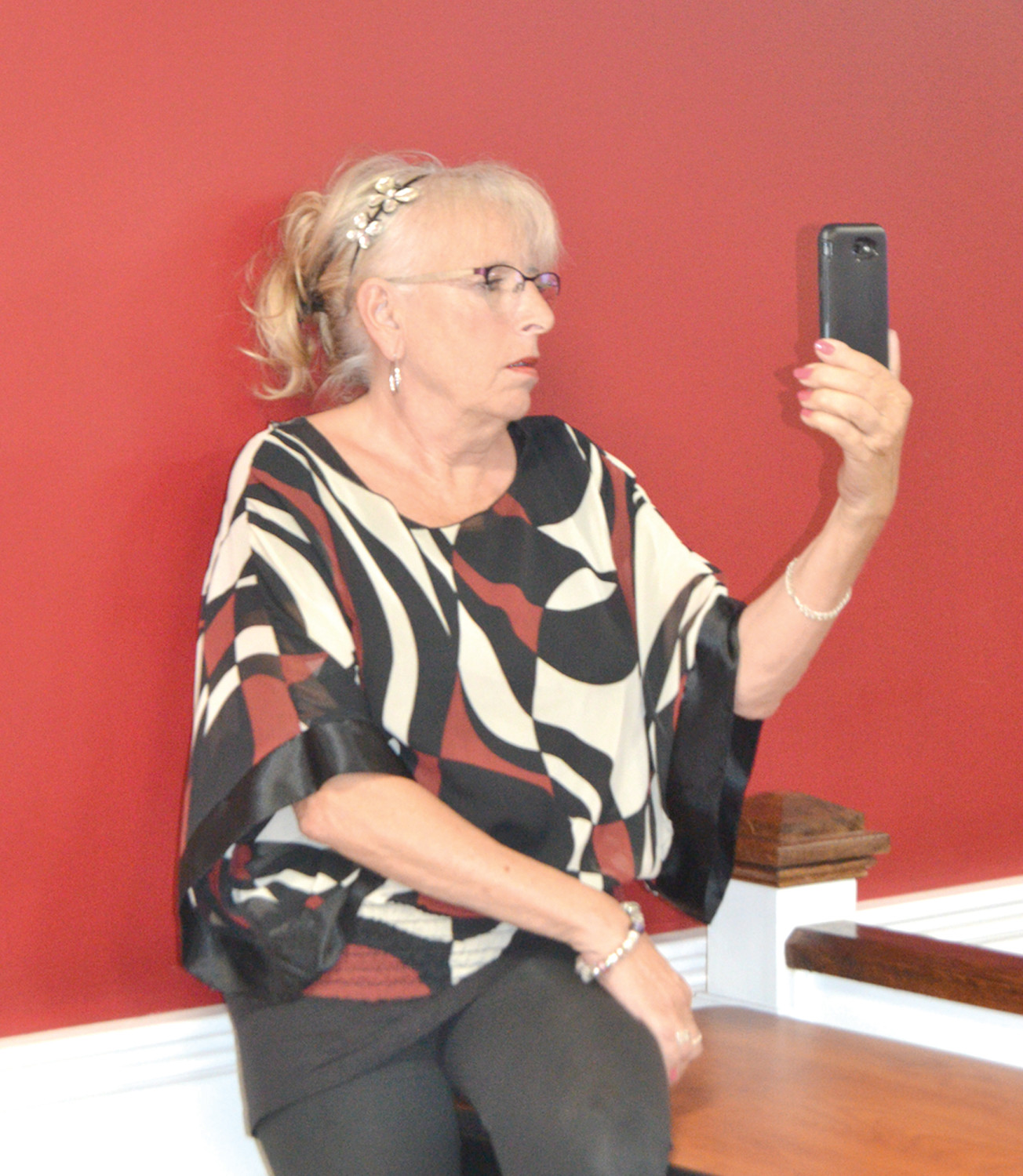 ON THE RECORD: Former Councilwoman Eileen Fuoco records the Town Council meeting as the Mayor's indemnification was discussed.