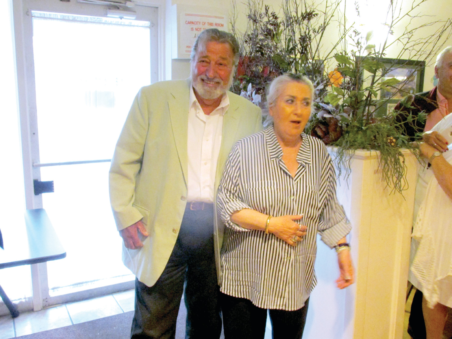 "SURPRISE, SURPRISE: Elly Palumbo reacts to being ""completely surprised"" back on June 27 when her husband of 50 years Vin Palumbo pulled off a special surprise party on the actual day of her birthday. (Sun Rise photos by Pete Fontaine)"