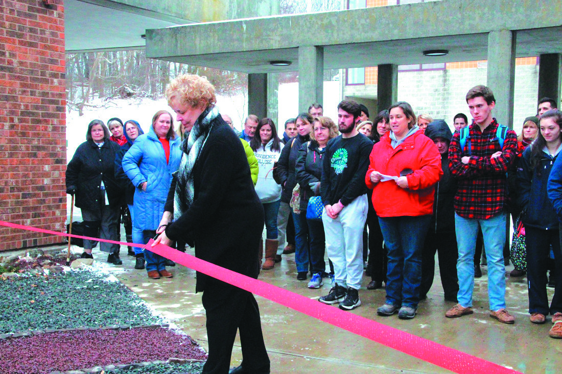 A GARDEN OF MEMORIES: Barbara Chrabaszcz cuts the ribbon to the memorial rock garden dedicated by the seniors of the Toll Gate class of 2018 in a December ceremony to honor the life of her late husband.