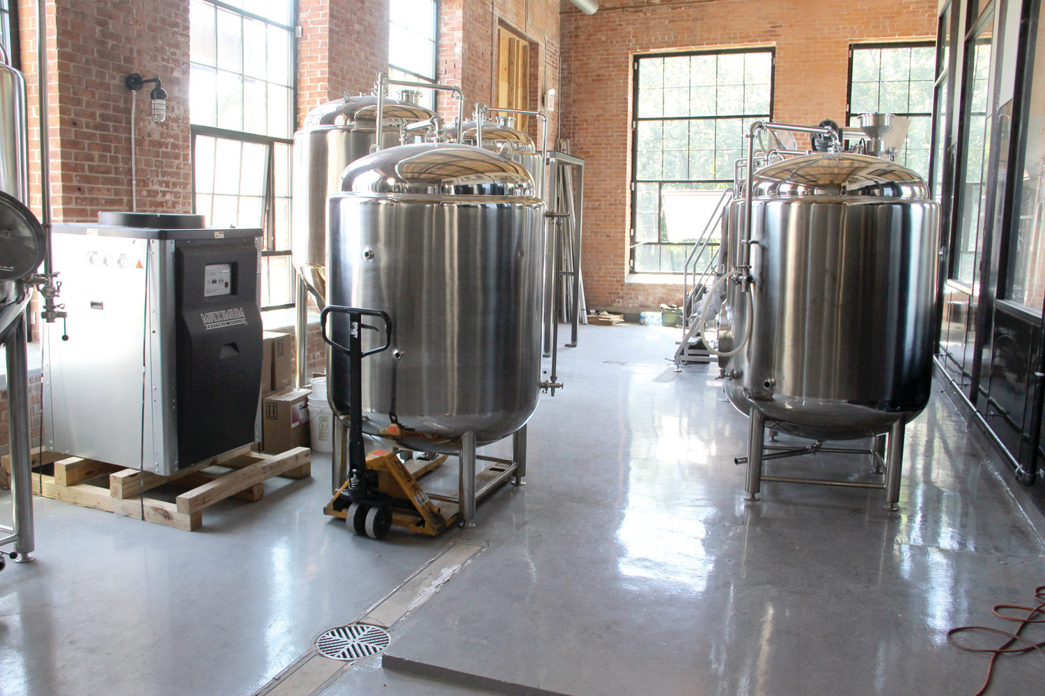 SOMETHING'S BREWIN': Apponaug Brewing Company is raring to go, with their first brewing location already set up in a commercial space at the Mills. These fermentation tanks here can produce 310 gallons of beer. They hope to open before Labor Day.