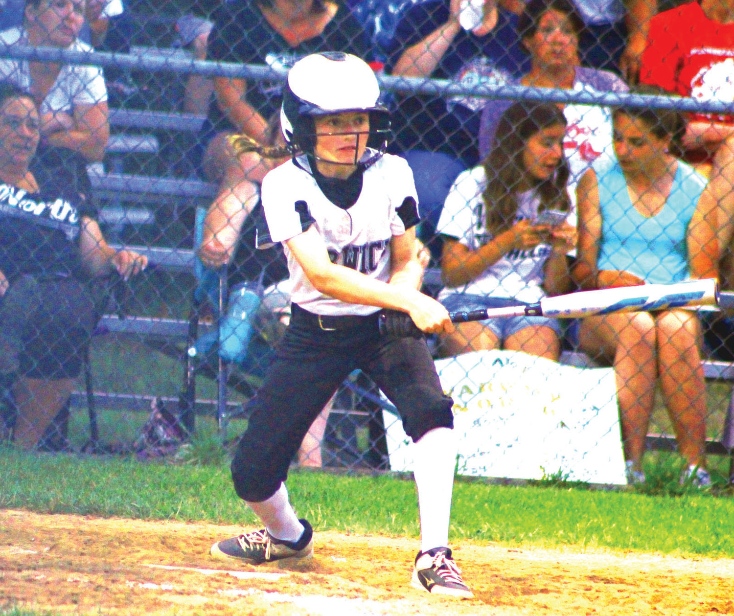 AT THE DISH: Warwick Little League North's Katie Motta makes contact against Cranston National Budlong.