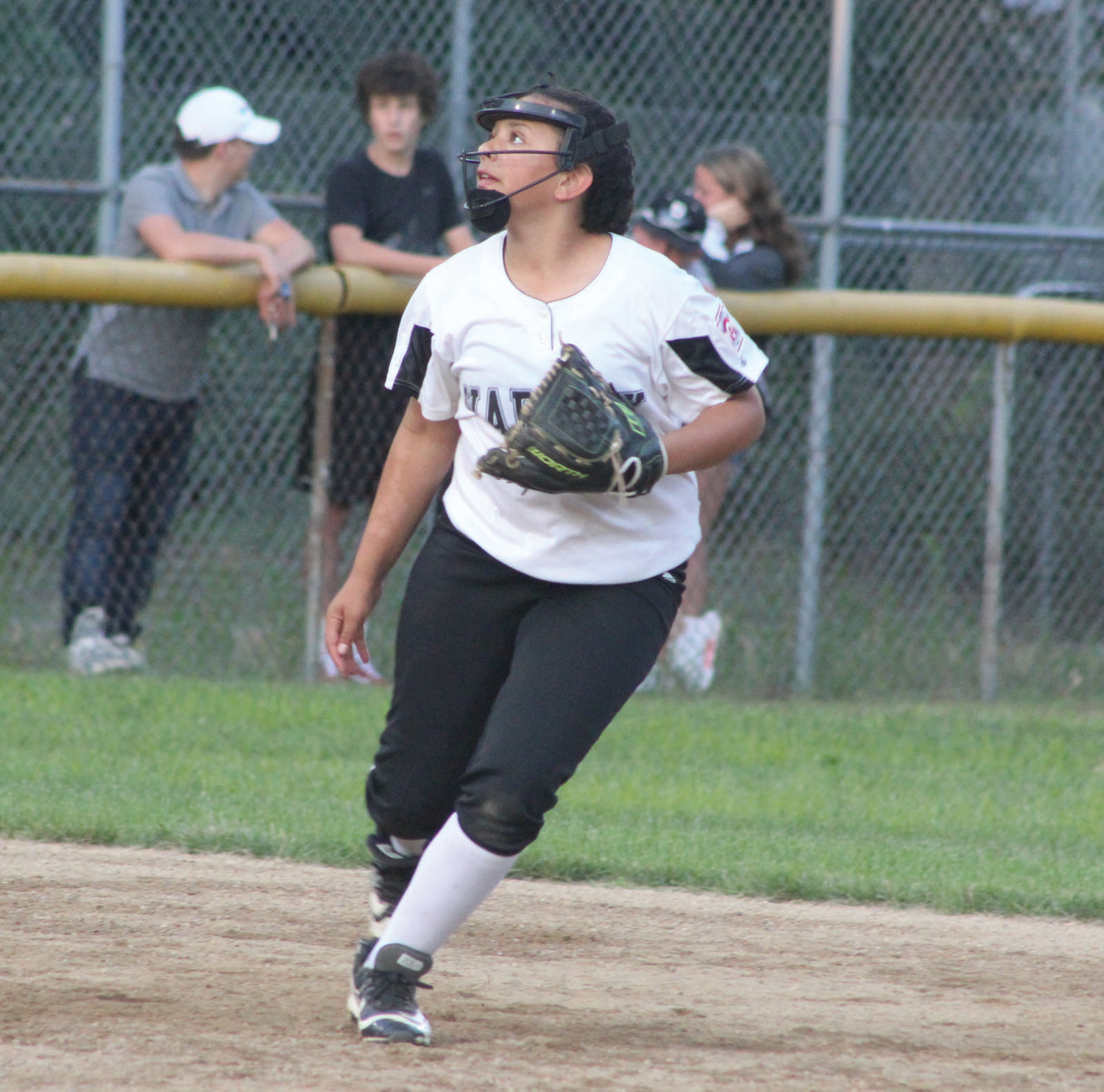 INFIELD FLY: Warwick Little League North shortstop Alayna Medina tracks down a fly ball against Cranston National Budlong on Monday evening. Cranston Budlong topped Warwick North 5-3 to send the 12's to the losers bracket. Warwick North then topped Cumberland 14-0.