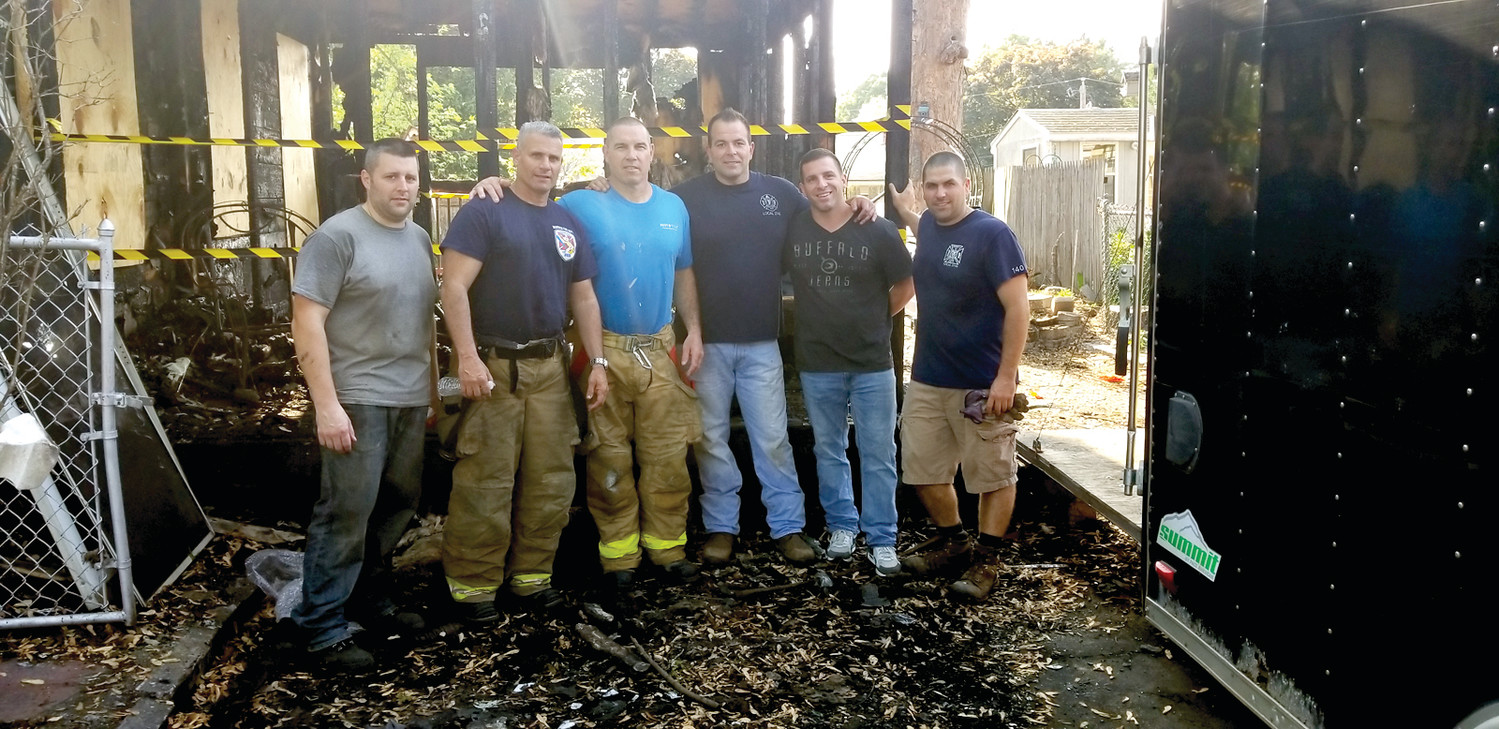 HELPING HANDS: A group of firefighters came to help Barabara Carlow and her family recover from the destruction of the blaze. From left are Firefighter Ken Marriott, Captain Mike Scalzo, Firefighter Michael Boynton, Sr., Captain Mike Carreiro, Firefighter Chris Zaino, and Firefighter Matt Jarbeau.