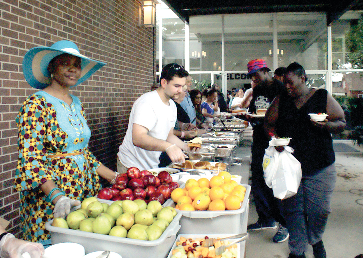 SERVING UP THE GOOD STUFF: Pears and apples were among the foods served on the dessert table to the homeless at Praise Tabernacle Church Sunday.