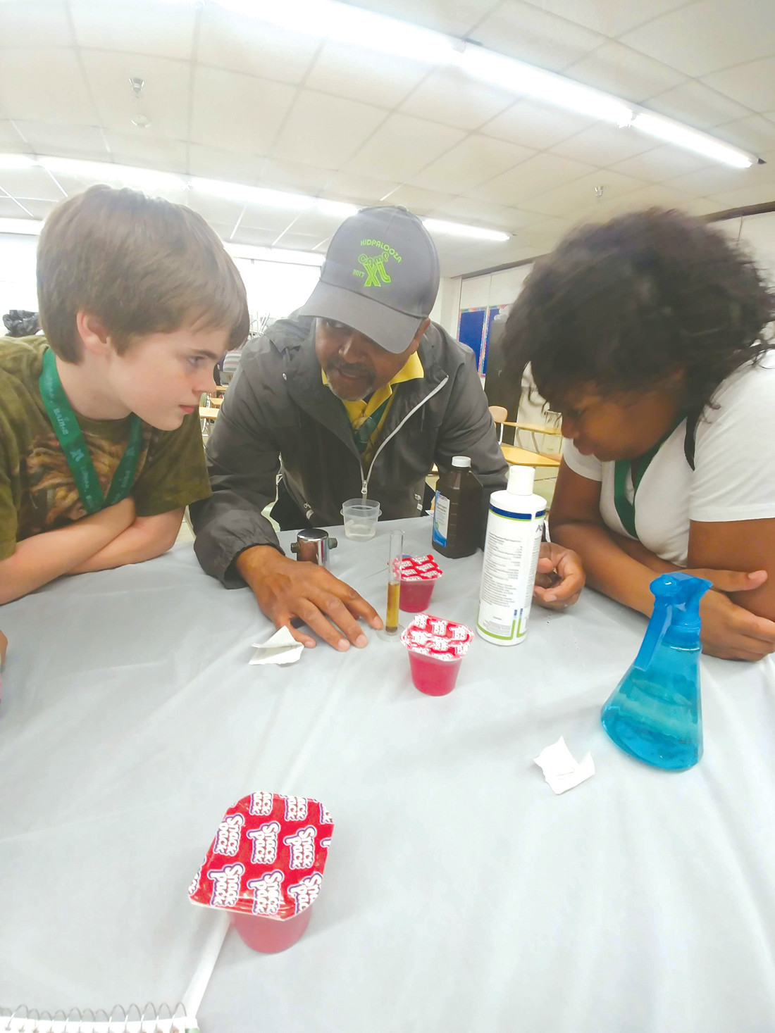 WILL IT WORK: Dr. Jesse Jordan and two of his students, Nyleiha McCants Snead and James Seal examine a solution being used in a jello experiment.