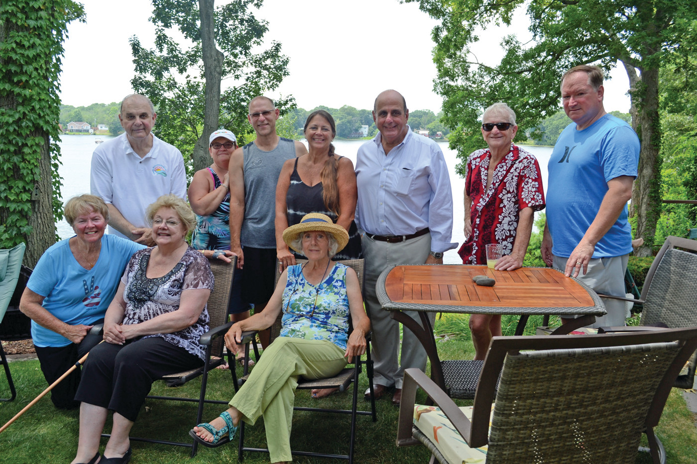 FRIENDS OF PONDS AND EACH OTHER: A post-parade barbeque gave everyone a chance to get together. Left to right, top row – Philip D'Ercole, Diane Clark, Doug Clark, Kimberlee Moore, Mayor Joseph Solomon, Bill DeNuccio, Sen. Michael McCaffrey; Lower level – Marybeth DeNuccio, Carmen D'Ercole and Jeannine Anderson. Those who showed up after the picture was taken included Madeline and Bob White, Jim and Maureen Wishart, Ruth Page and Rob Franzen and Mike Strashnick.