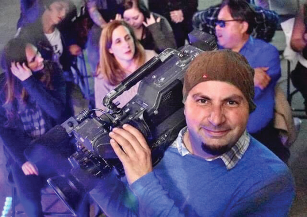 JACK OF ALL TRADES: Russo, pictured here behind the camera rather than in front of it, prides himself on being able to work in a variety of formats within the film industry, from acting to production and editing the footage as well into a final product.