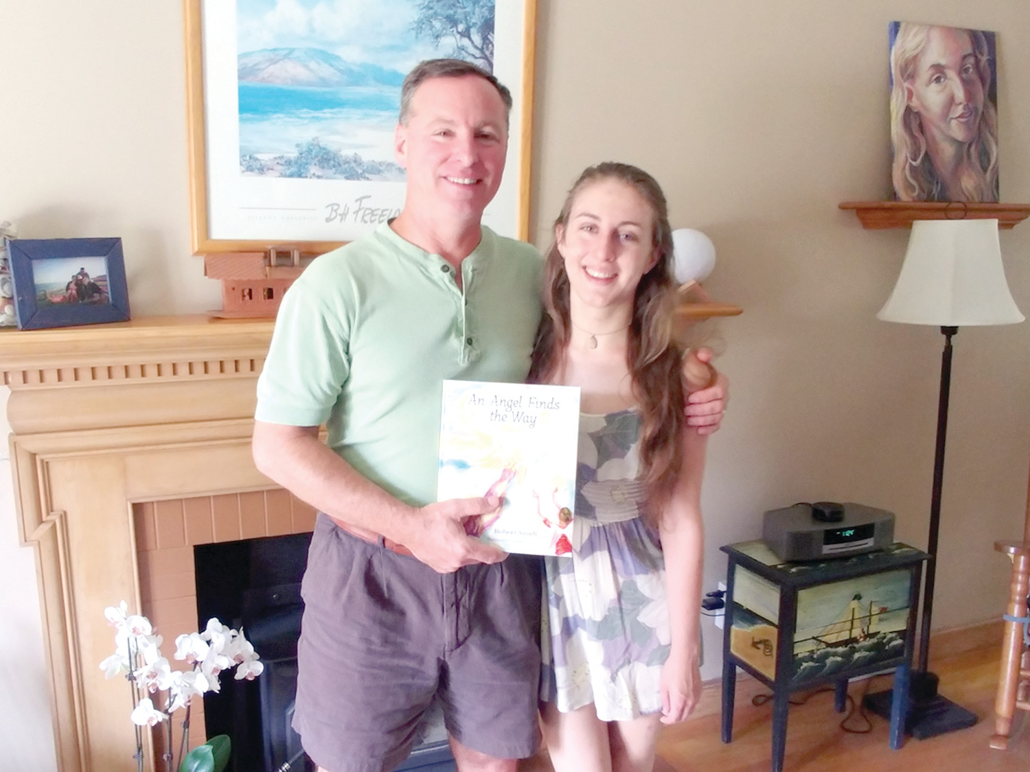 A FATHER, A DAUGHTER, A BOOK: Robert and Alexandra Smith pose together with the book written by him and illustrated by her, a labor of love spanning nearly six years.