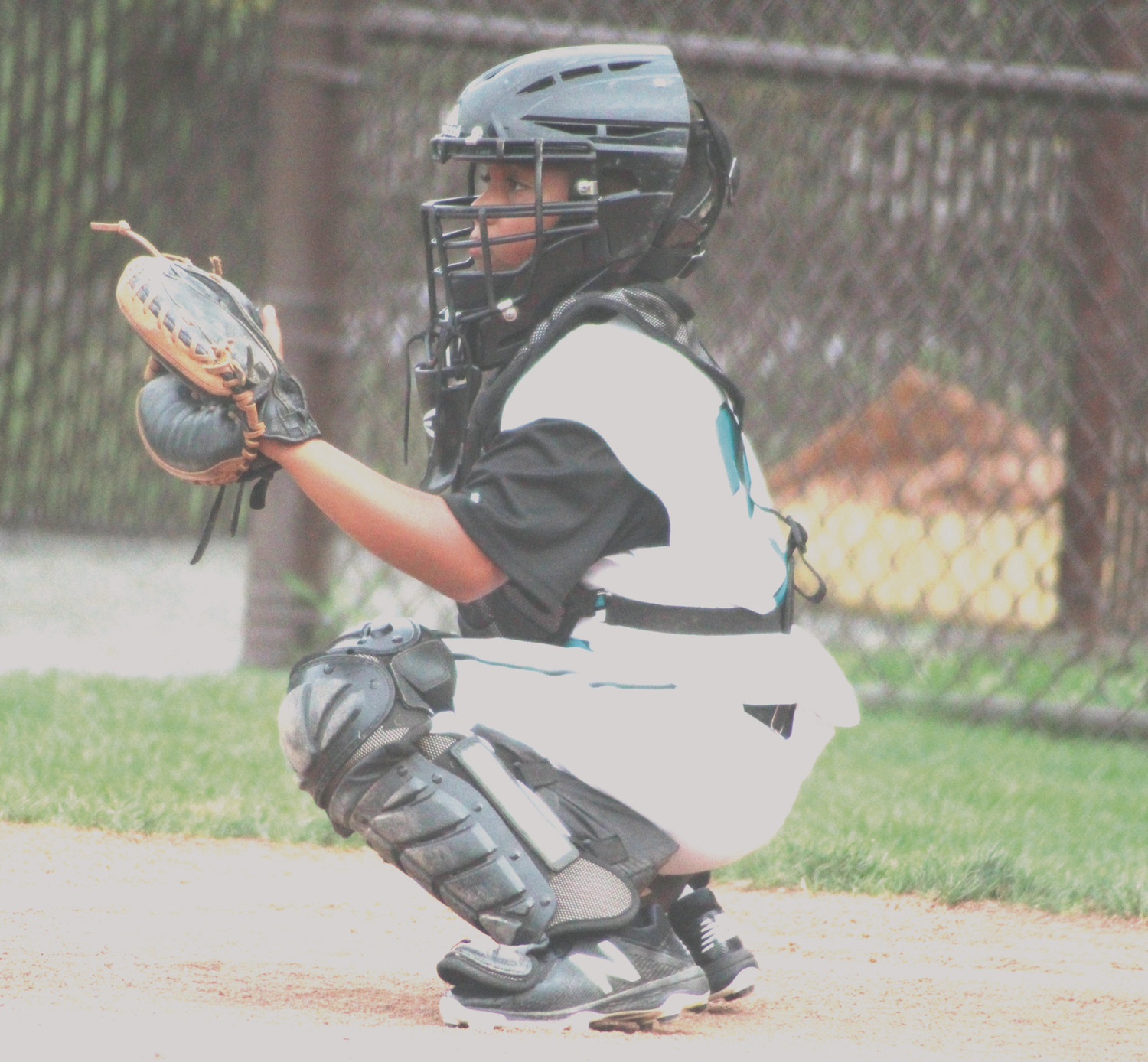 CALLING THE SHOTS: Cranston Western's Jeremy Silverio catching.