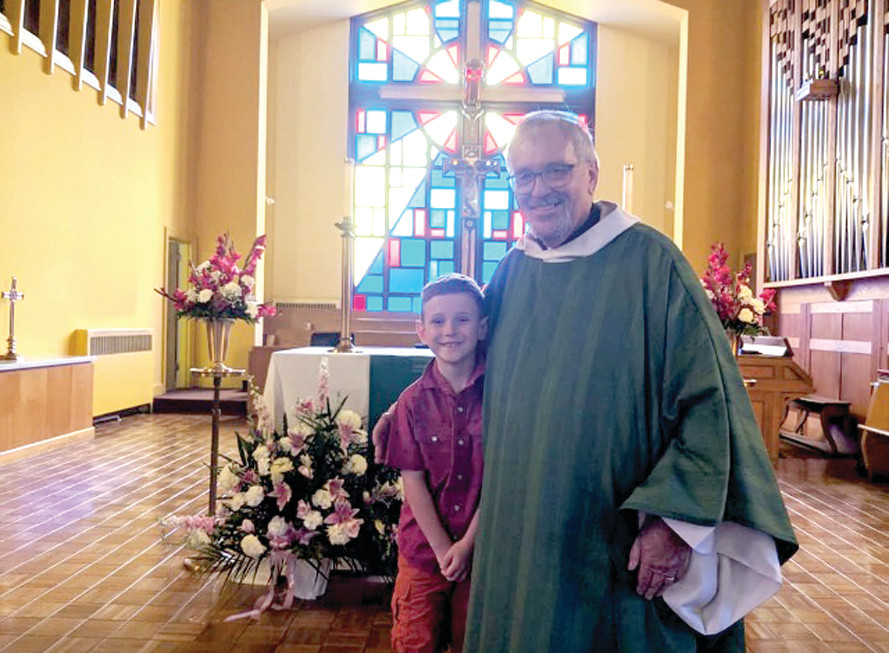 A CELEBRATION: Pastor Dennis Kohl at the First Communion of his grandson, Arlen McMahon, on July 21.