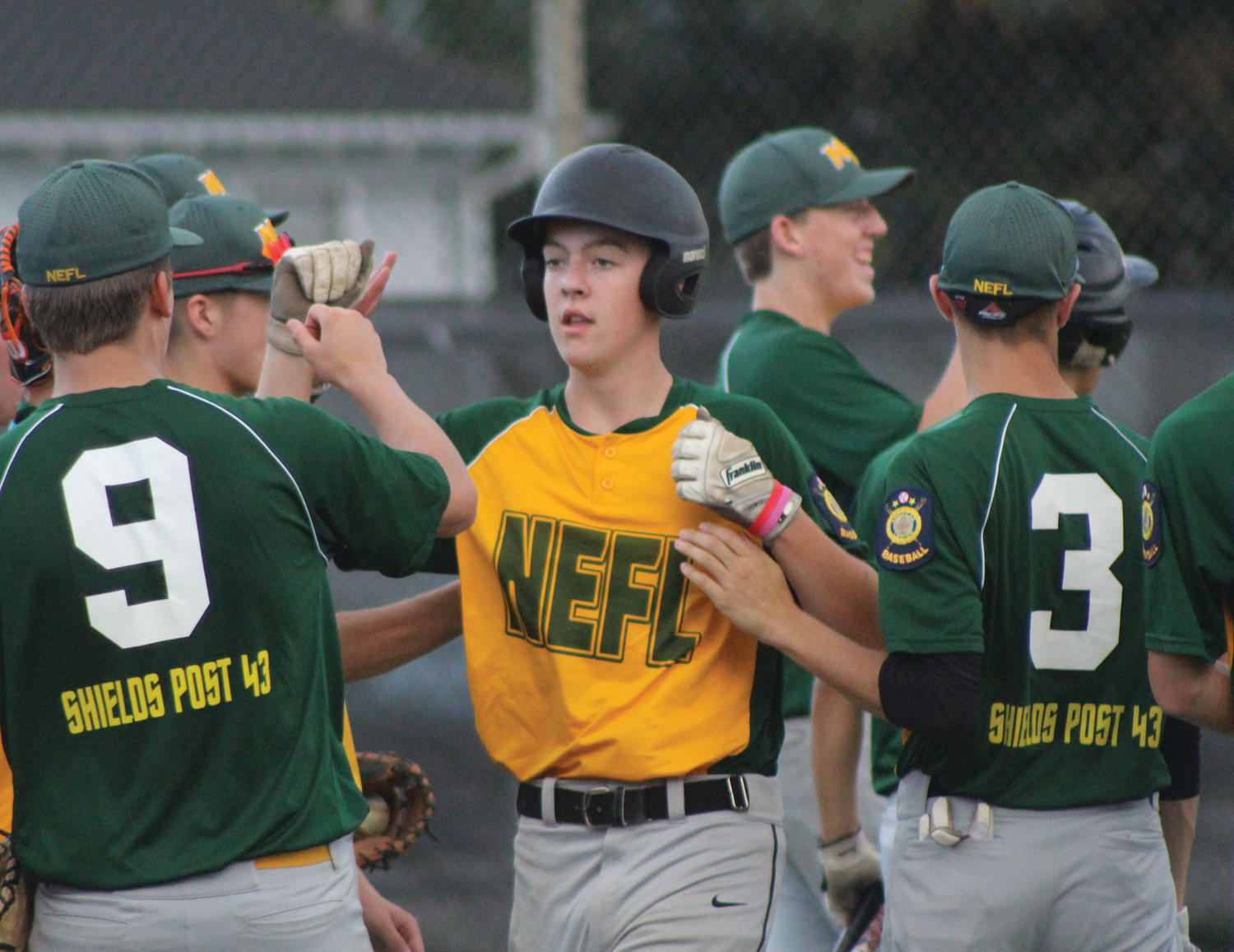 SEASON IN THE BOOKS: The New England Frozen Lemonade Legion baseball team celebrates against Upper Deck.