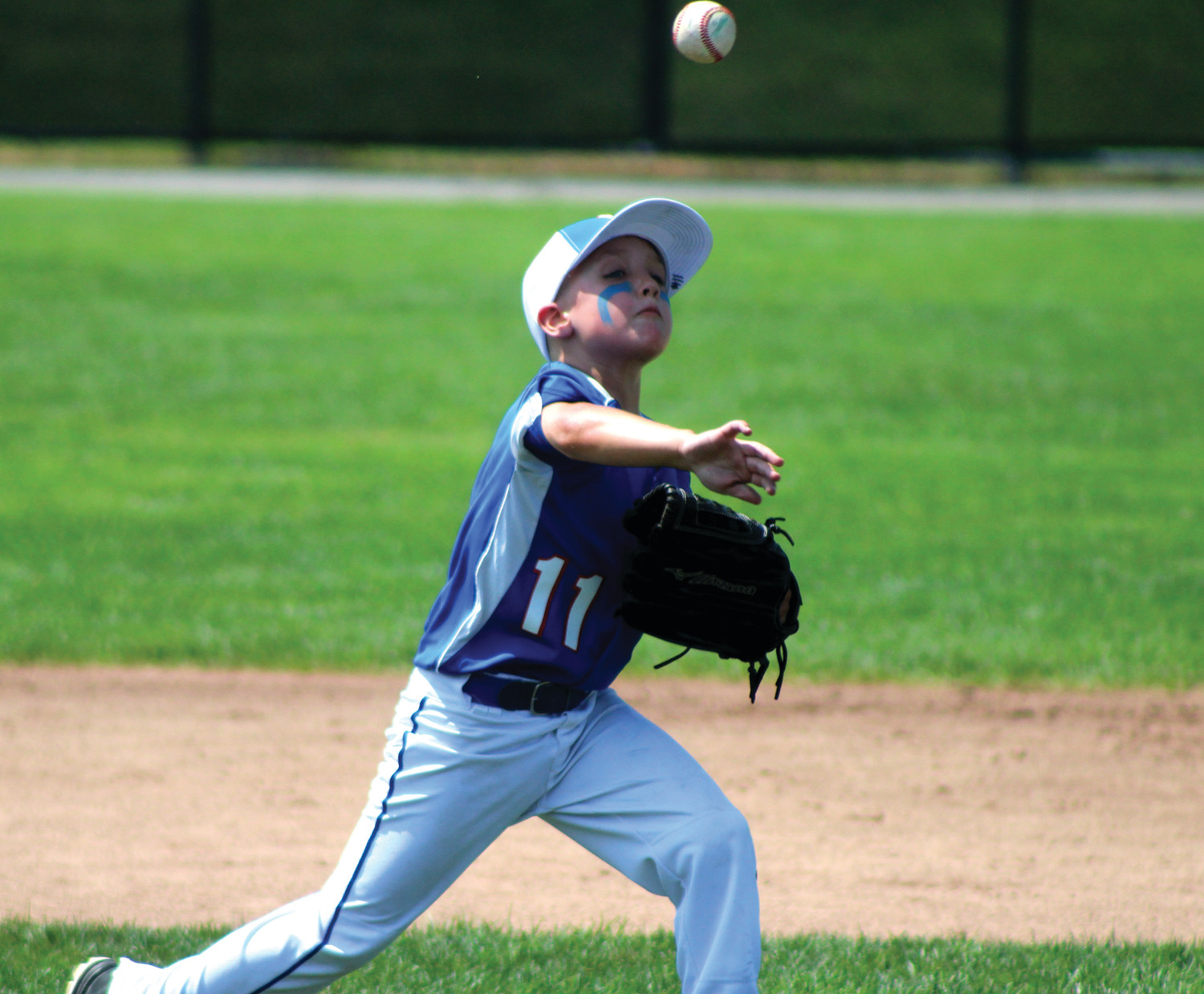Warwick Continental infielder Charlie Brown makes a throw to first base.
