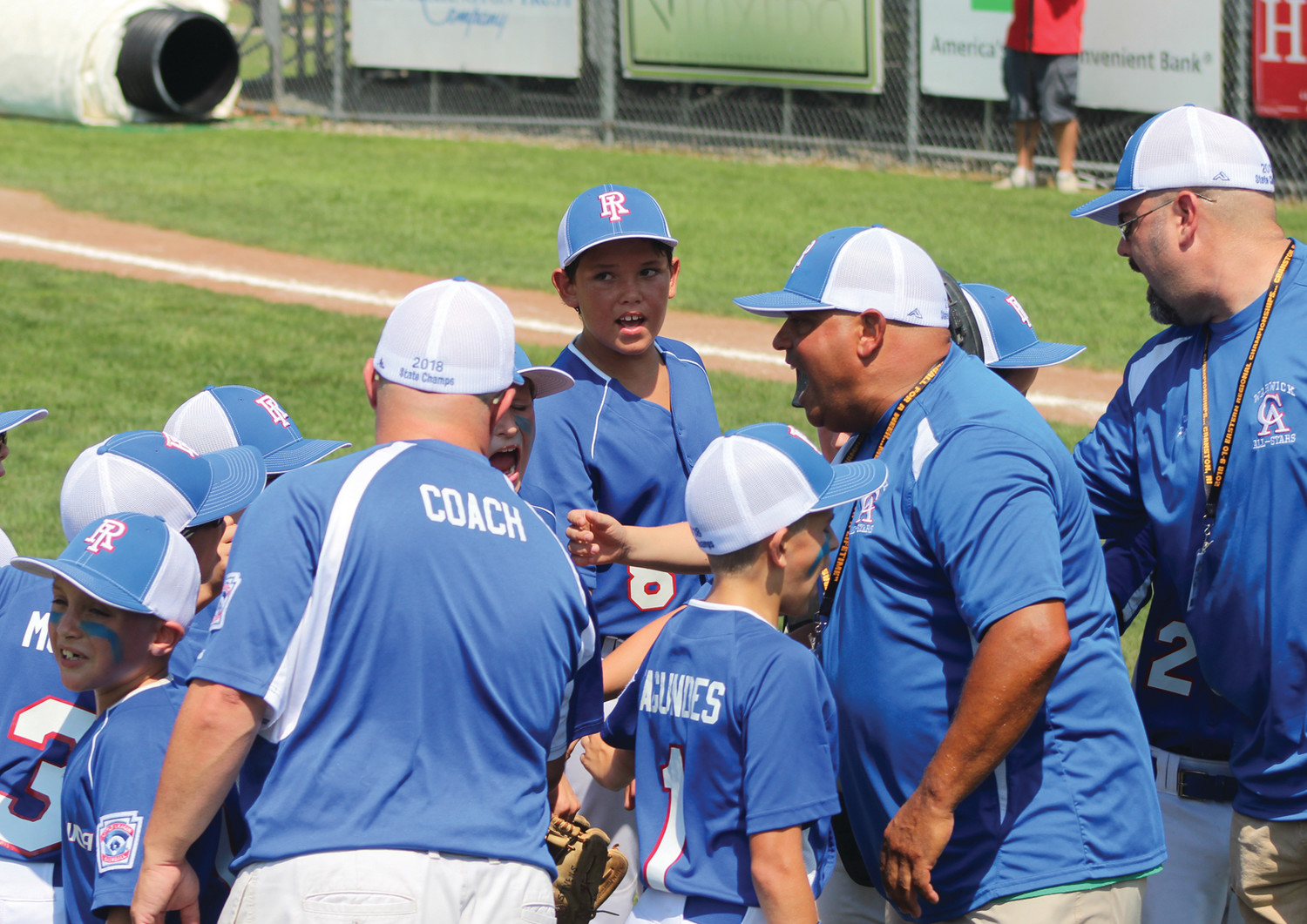TALKING STRATEGY: The Warwick Continental Little League team talks strategy in between innings against South Portland, Maine in the 2018 Little League East Regional tournament in Cranston on Monday afternoon.