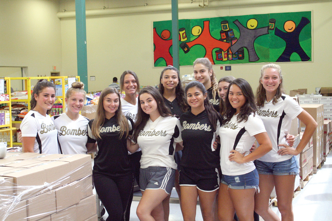 CRANSTON PRIDE: The CLCF Bombers Gold team gathers for a photo during their volunteer hours at the Rhode Island Food Bank. Back row from left to right: Aspen Ryan, Livia Feole (captain), Ada Bruno, Megan Cooney (captain), and Brenna Whittaker. Front row from left to right: Maddison Marcello, Emma Petrucci, Amber Carnevale (captain), Olivia Marfeo, Julia Hazian and Sarah Danella.
