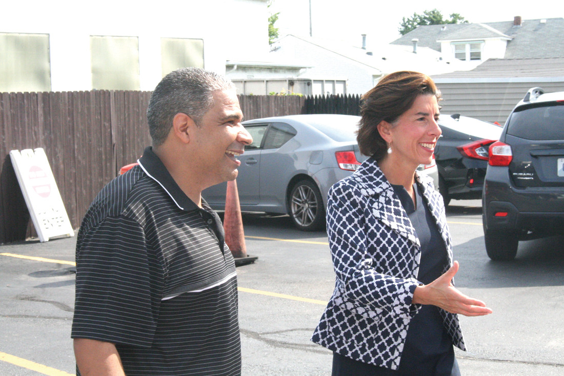 GOVERNOR'S GREETINGS: Richard Bisono, owner of New England Highway Technologies in Cranston, greets the Governor as she arrives at the event on Monday.
