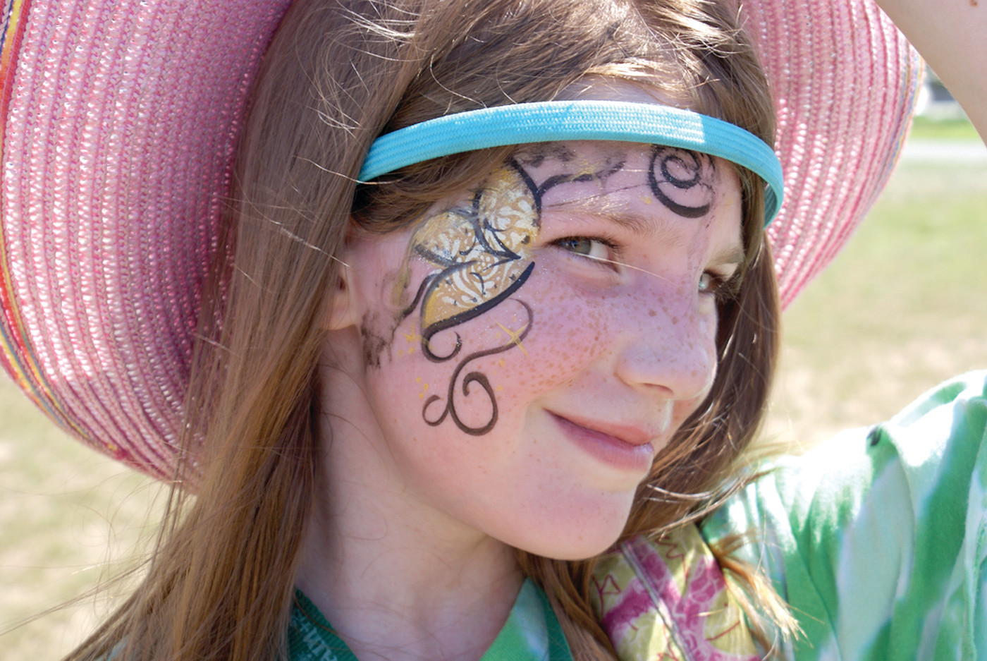 A HAPPY CAMPER: A member of the Rhode Trippin' group from Camp XL, Tomi Seal, enjoyed Kidpalooza and having her face painted during the event