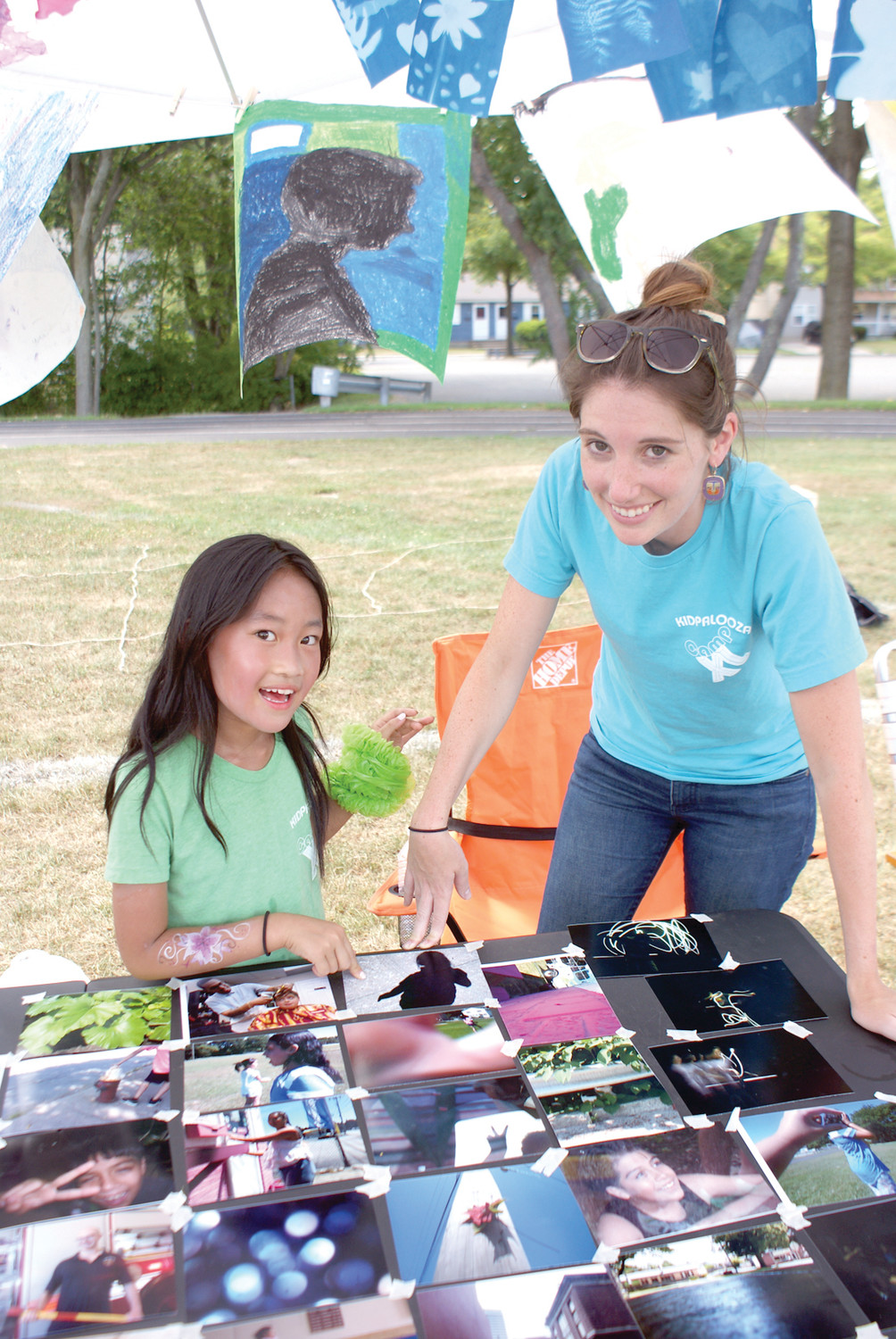 PHOTO GROUP: Amanda Chen, age 9, is pictured with her Photography Instructor from Camp XL, Alicia Turbitt. They highlighted photographs and silhouettes by camp members.