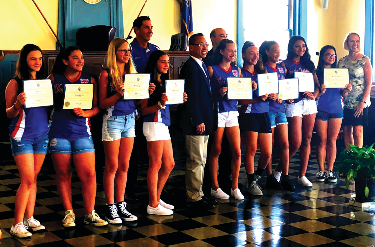 SPECIAL GUESTS: The Cranston National Budlong senior Little League softball team takes a photo with Cranston Mayor Allan Fung at city hall on Tuesday morning.