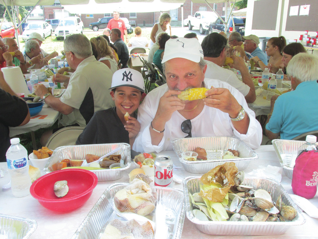 GRAMPS GRUB: Al Vendetti enjoys an ear of corn on the cob during Sunday's OLG clambake that he enjoyed with his son (not shown) and grandson Anthony, 10, who opts for a piece of chicken.