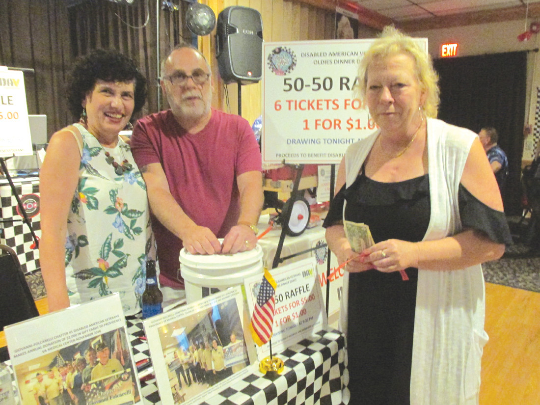 The always-popular 50/50 raffle – which was conducted by Ernestine Vota and Dennis Caldarone during Saturday evening's Oldies Dinner/Dance and featured people like Lori Cogean buying tickets – helped boost the profits to help homeless veterans and their families. (Sun Rise photos by Pete Fontaine)