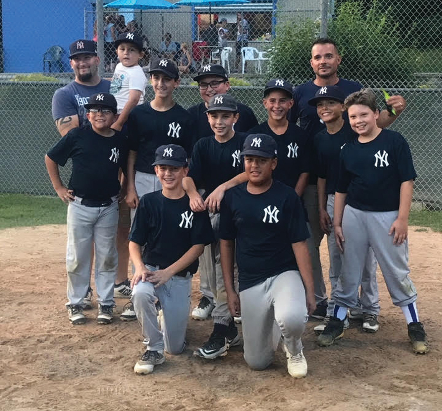 TOP TEAM: Members of the Northeast Auto Body-sponsored Yankees display their Johnston Little League finish after staking claim to the Town Championship last Friday night.  (Submitted photo)