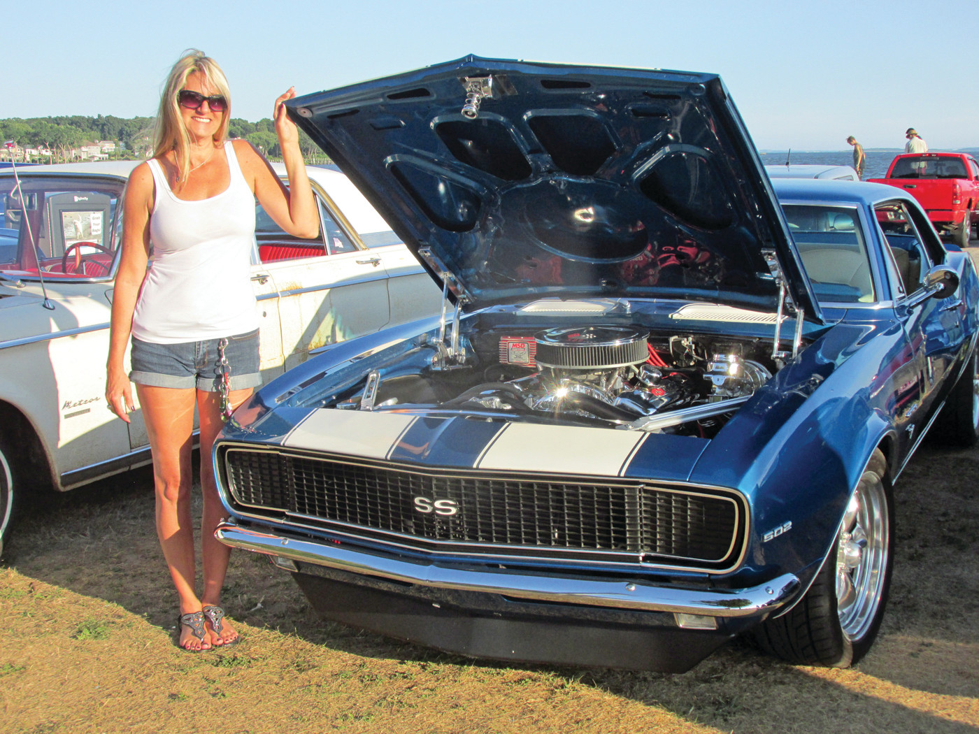VINTAGE VEHICLE: Kristen Collard is the proud owner of this shiny blue 1967 Chevrolet Camaro that has a ZZ 502 engine and is an example of the many classic cars that will be at Saturday's Cruising at the Crowne Car Show in Warwick.