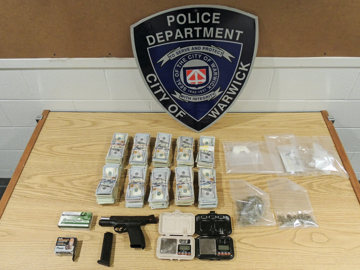 LARGE BUST: Warwick Police recovered about $100,000 and vast amounts of narcotics (including one tenth of a pound of deadly fentanyl) and a loaded handgun from a Warwick resident last Thursday.