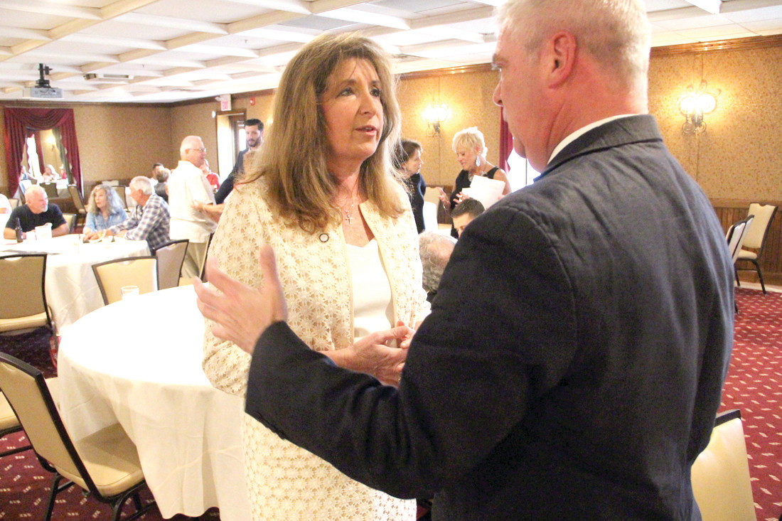 LONG-TIME FRIENDS: Sue Stenhouse and former Mayor Scott Avedisian chat at Tuesday's fundraiser where Stenhouse told supporters why she is running for mayor. Stenhouse served as the councilwoman from Ward 1 during Avedisian's tenure as mayor.