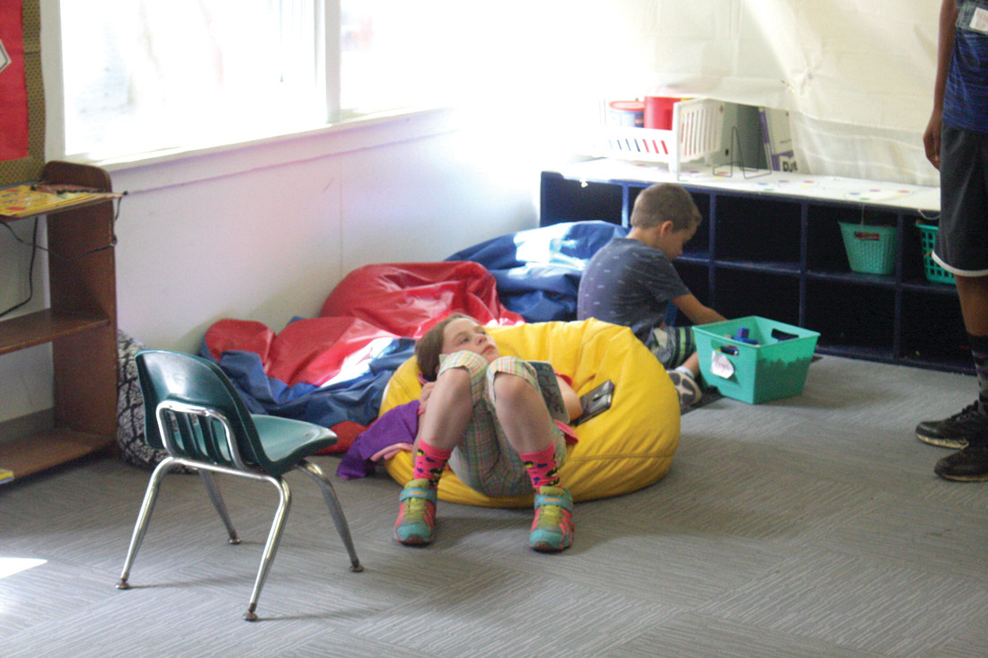 TAKING A BREAK: Dallas P. takes some time away from the hot outdoors in the camp's 'balance center,' where students can go to cool down and relax, according to camp operations director Lauren Utschig.