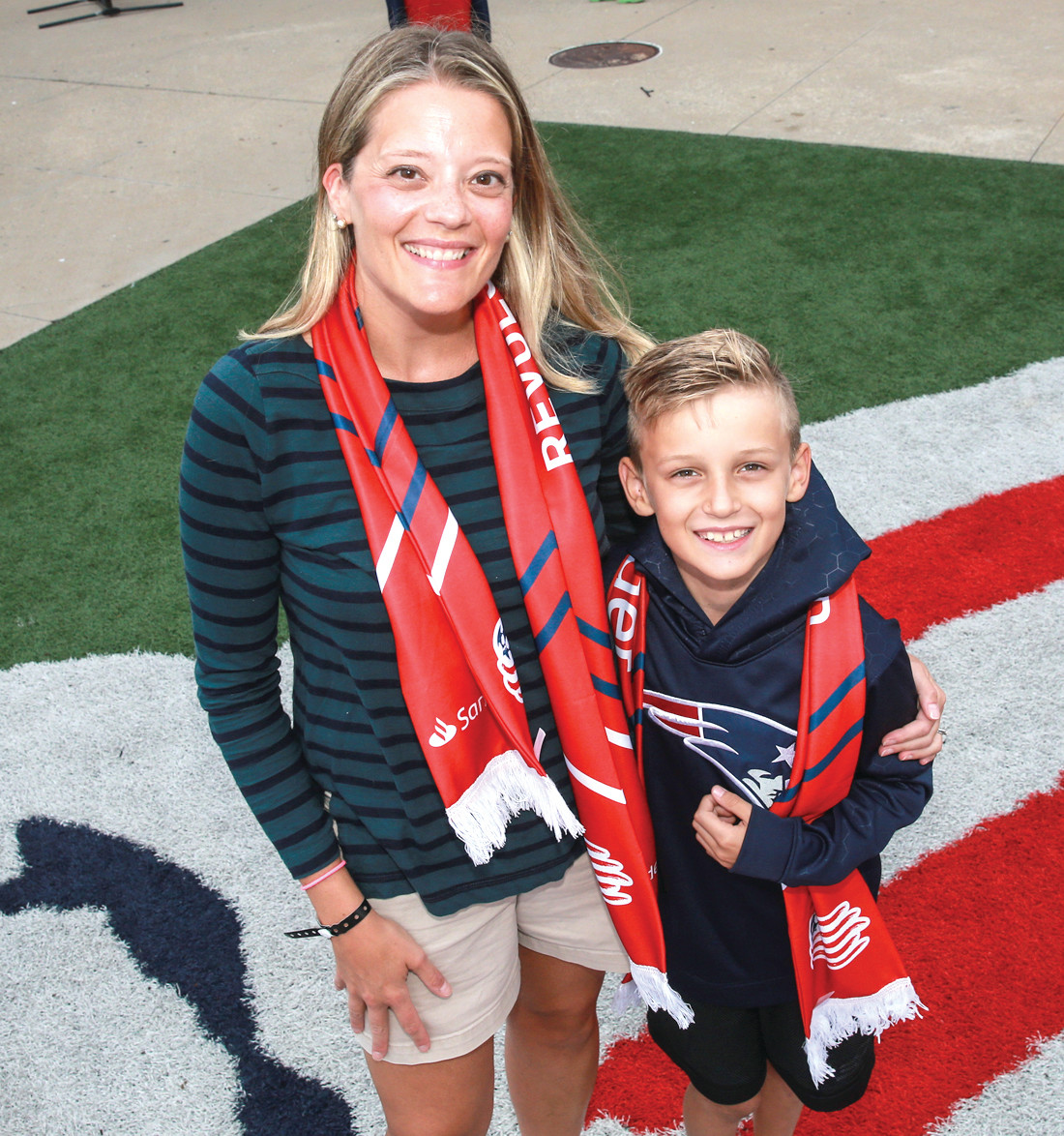 APPRECIATED: Amanda Cronin of Walpole, Mass., a Ferri Middle School teacherm was joined by her nephew Andrew Veres, 8, of East Longmeadow, MA before being honored during Santander Bank's Teacher Appreciation Day at the New England Revolution game on August 11.