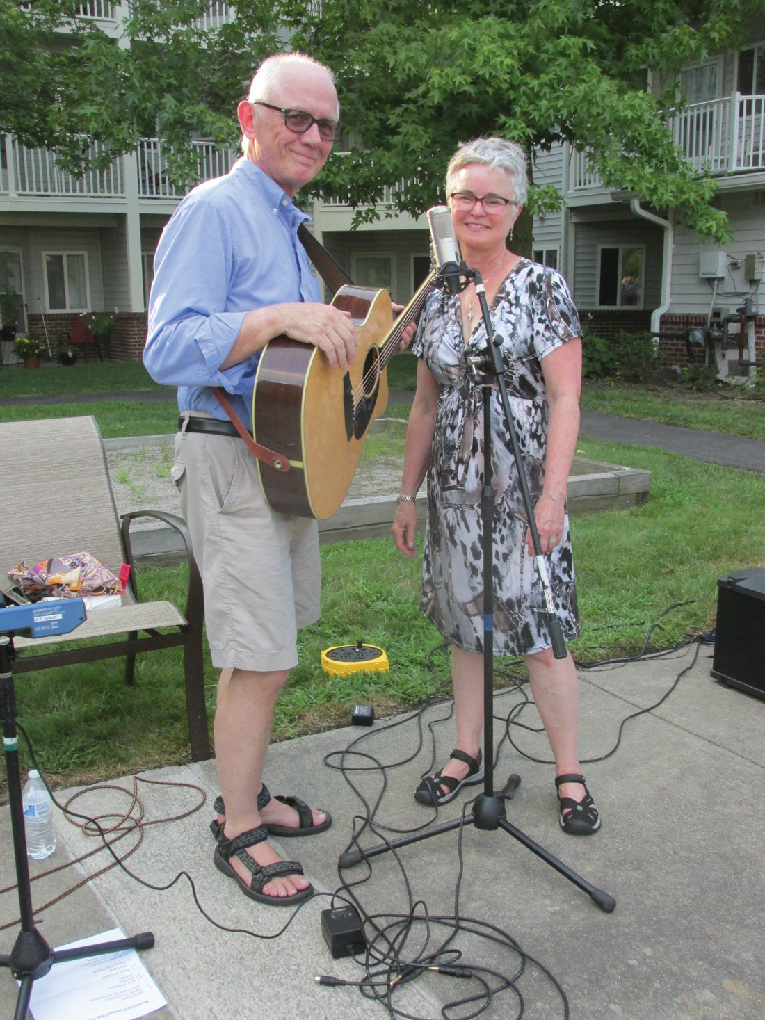 MUSIC MAKERS: Ned and Alice Pace, who play music under the title of Well Ordered Transitions, helped make last week's Christmas in July Barbeque special at Brookdale Pocasset Bay in Johnston.