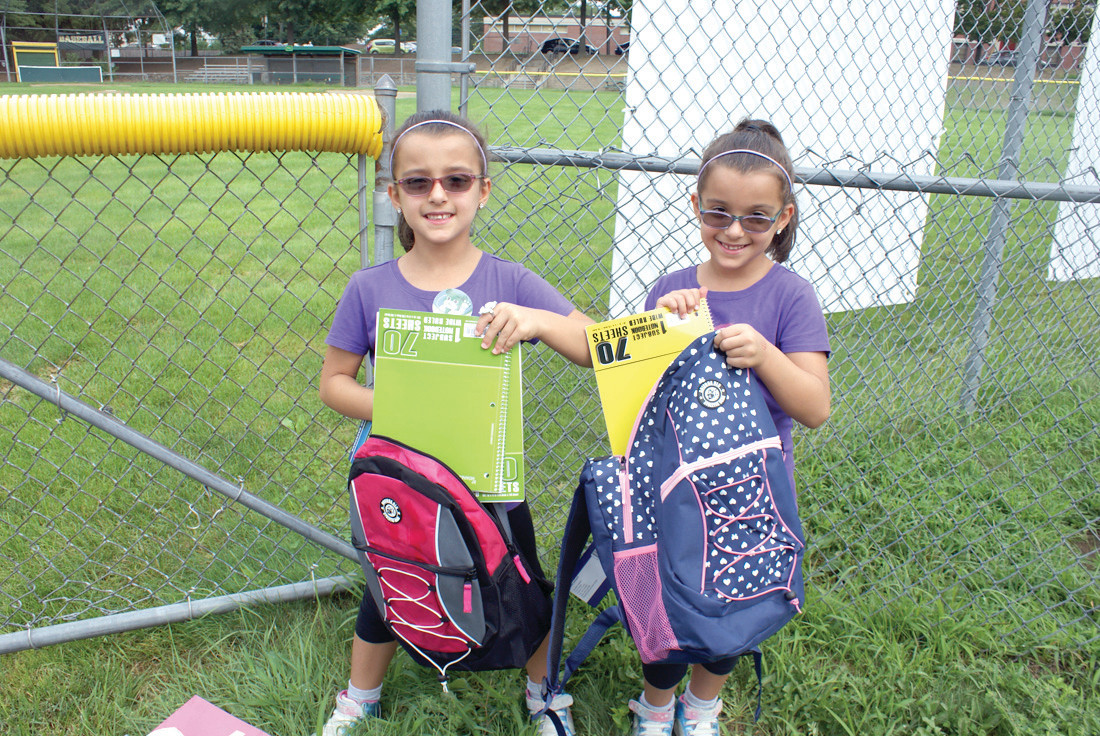 DOUBLE THE FUN: Twins, Kiara and Siena Prezioso, age 7, of Cranston received the free backpacks this past Saturday at the Back To School Celebration RI, which were full of school supplies. They will be entering the 2nd Grade at Orchard Farms in a couple of weeks.