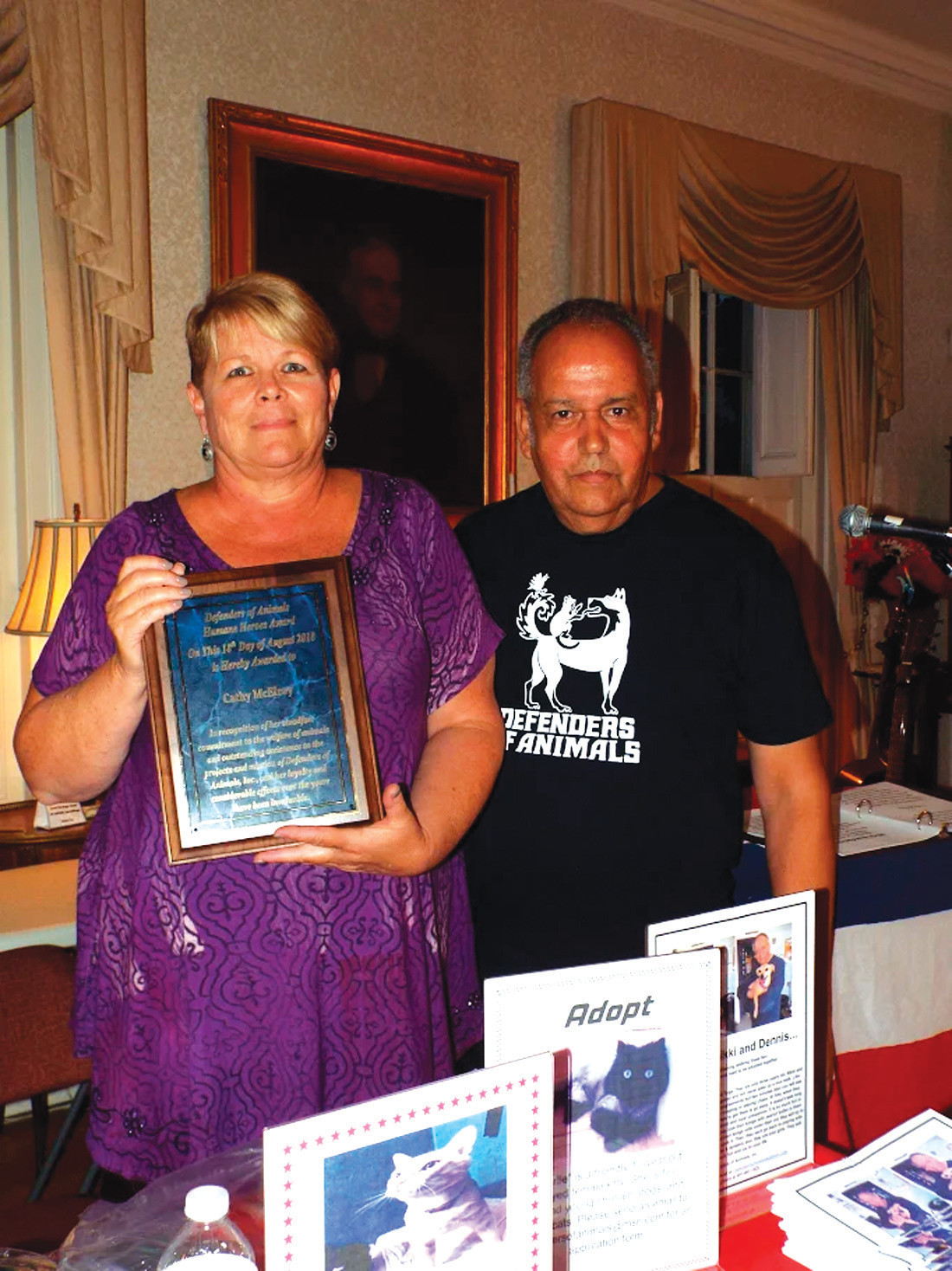 VOLUNTEER : Receiving a Humane Heroes Award from Defenders of Animals this past weekend was Cathy McElroy of Cranston who has provided countless hours of volunteer work. She is pictured with Dennis Tabella, Director of Defenders of Animals.