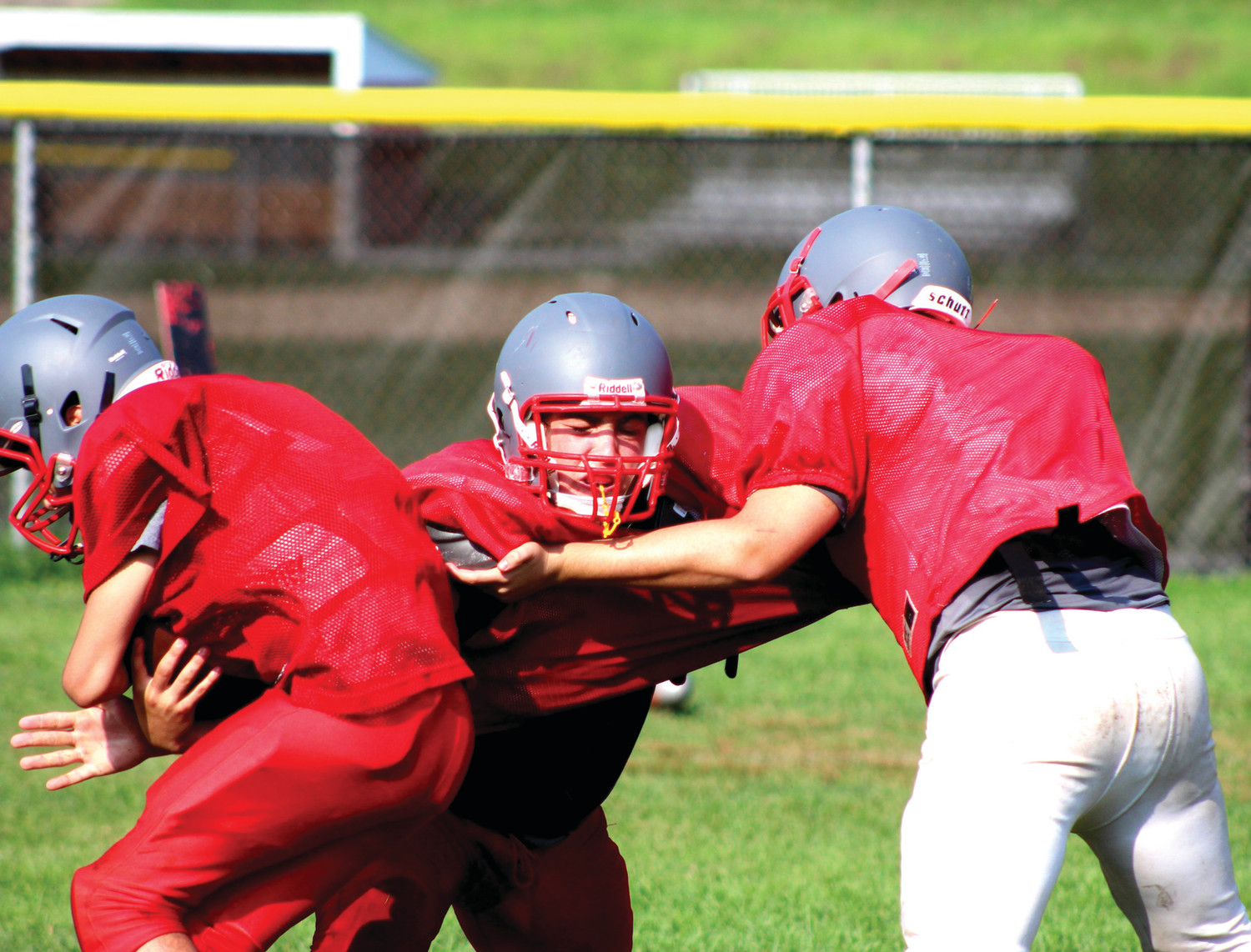TRAINING CAMP: Members of the Cranston West football team grind through training camp last week in preparation for the 2018 regular season.