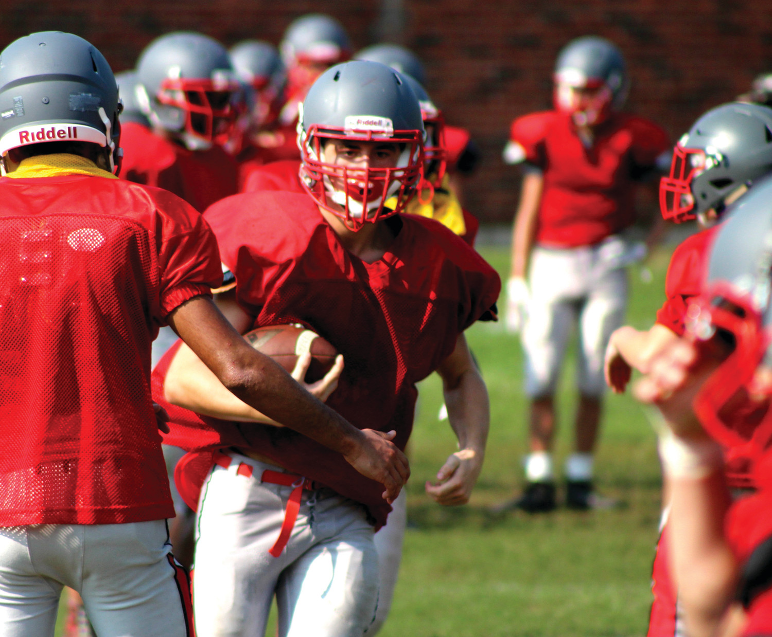 COUNTDOWN TO KICKOFF: After snapping a 10-year long playoff drought in 2017, the Cranston West football team beat the odds and qualified for the postseason. Despite losing to rival Cranston East in the opening round of the playoffs, the Falcons are confident heading into the 2018 regular season, and are hungry to build off of last year's success. Pictured are West football players running through drills during a practice last week at Cranston West.