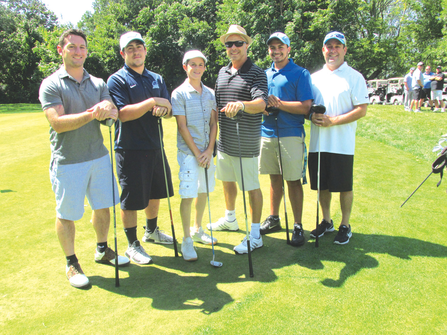 TOP TEAM: Team Pingitore, which included players Joe Pingitore and Dave Pingitore – as well as head coach Joe Acciardo and his son Joe Jr. – and Kyro Monteiro and Dave Pingitore took home top honors in the Panther Gridiron Club's Golf Tourney Sunday. (Sun Rise photo by Pete Fontaine)