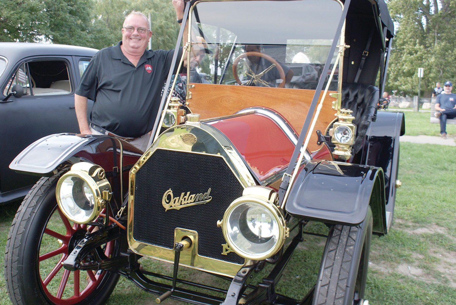 ONE OUT OF TWO: Keith Bailey proudly shows off his 1910 Oakland which is one of only two left in existence. His car was among the many on display at the Family Day Fundraiser to at Oakland Beach in Warwick.